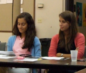 Playwright Isabel D'Angelo (right) listens to the read-through of playwright Hannah Newman's (left) play at the first rehearsal for the Young Playwrights Festival.